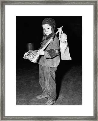 Young Boy Flees Floods Framed Print