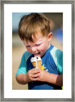 Young Boy Licking An Ice Cream Framed Print by Samuel Ashfield