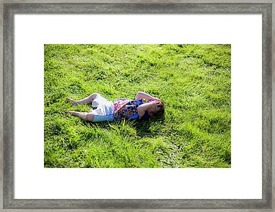 Young Boy Lying On Grass Framed Print by Samuel Ashfield