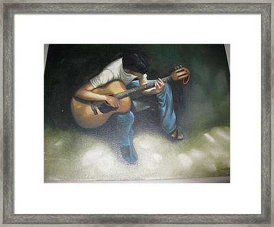 Young Boy Playing The Guitar Framed Print