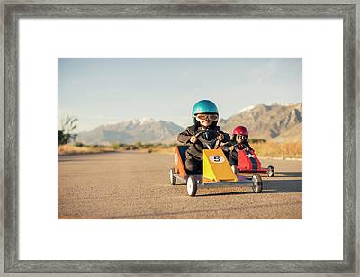 Young Boy Races Toy Car Wearing Framed Print by Richvintage