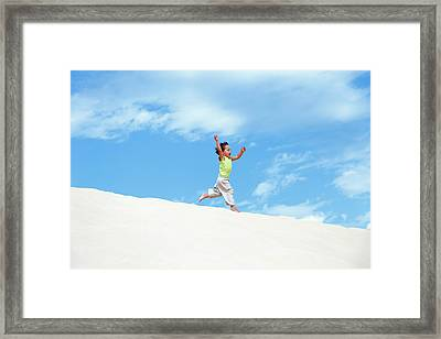 Young Boy Running On Sand Dunes Framed Print