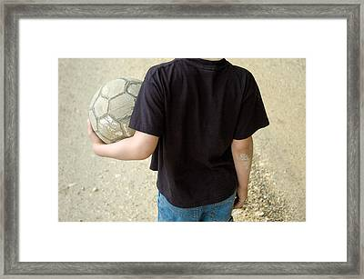 Young Boy With Soccer Ball Framed Print