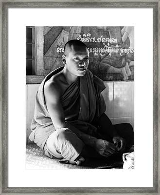 Young Buddhist Monk Framed Print by Alexey Stiop