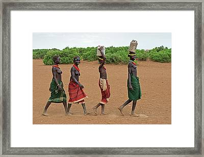 Young Dassenech Girls Carrying Water Framed Print