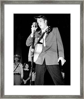 Young Elvis Presley Stands Over Microphone Framed Print