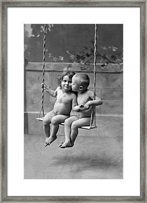 Young French Lovers On A Swing Framed Print by Underwood Archives