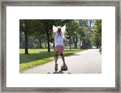 Young Girl Skateboarding While Wearing Framed Print by Mary Ellen McQuay