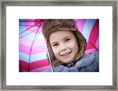 Young Girl Wearing Furry Hat With Umbrell Framed Print by Ruth Jenkinson