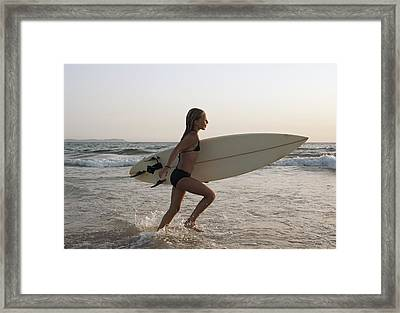 Young Girl With Surfboard Costa De La Framed Print by Ben Welsh