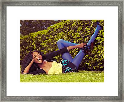 Young Happy Black Woman Lying On The Grass Framed Print by Oleksiy Maksymenko