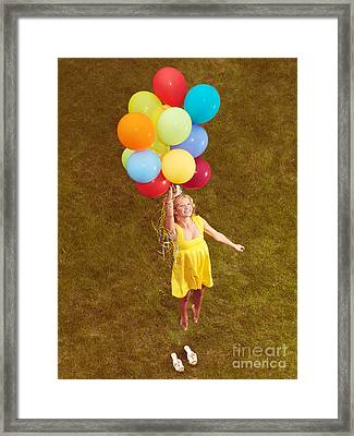 Young Happy Woman Flying On Colorful Helium Balloons Framed Print by Oleksiy Maksymenko