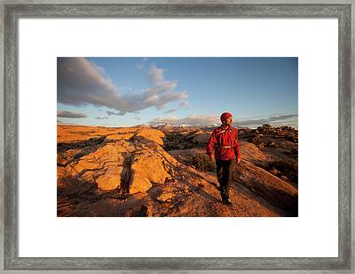 Young Man Hiking On Slickrock Framed Print