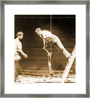 Young Man Leaning On A Horses Leg Framed Print
