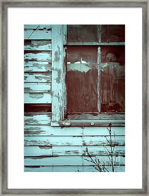 Young Man Looking Out Window Of Abandoned Building Framed Print