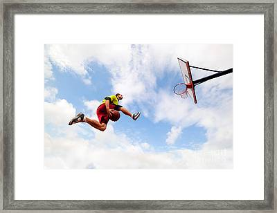 Young Man Making A Fantastic Slam Dunk Playing Streetball Basketball Framed Print