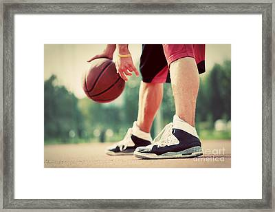 Young Man On Basketball Court Dribbling With Bal Framed Print by Michal Bednarek