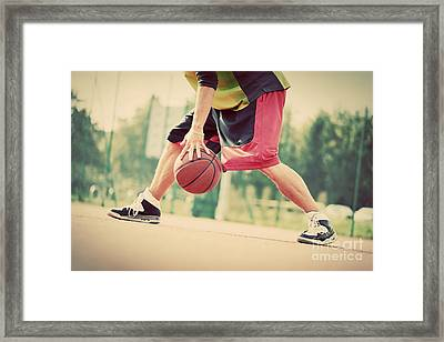 Young Man On Basketball Court Dribbling With Ball Framed Print