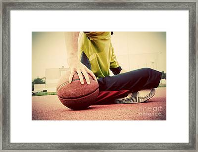 Young Man On Basketball Court Framed Print by Michal Bednarek