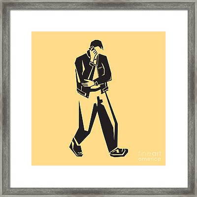 Young Man Talking On A Cell Phone  While Walking Framed Print