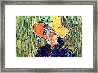 Young Peasant Girl In A Straw Hat Sitting In Front Of A Wheatfield Framed Print by Vincent van Gogh