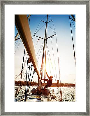 Young Sailor On Sailboat Framed Print by Anna Om