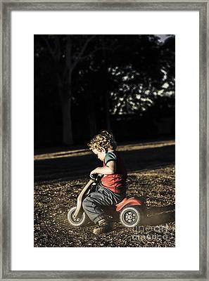 Young Three Year Old Child Riding On Toy Bicycle Framed Print