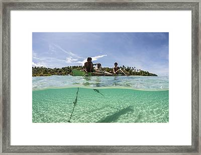 Young Villagers Fish Framed Print
