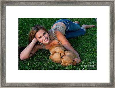 Young Woman And Golden Retriever Puppies Framed Print by Linda Freshwaters Arndt