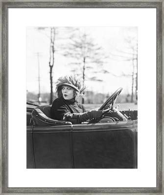 Young Woman At The Wheel Framed Print