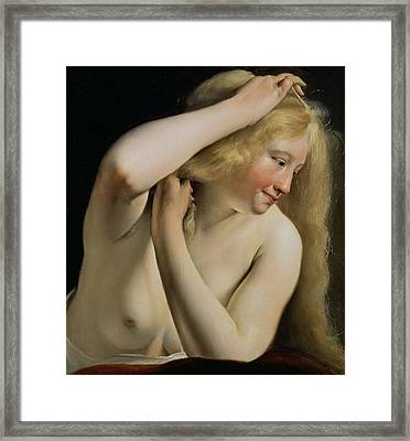 Young Woman Combing Her Hair Framed Print