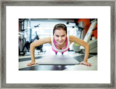 Young Woman Doing Press-ups Framed Print by Science Photo Library