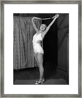 Young Woman Exercising Framed Print