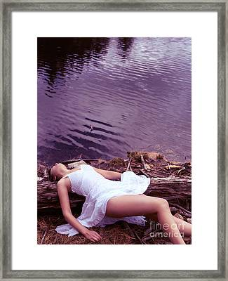 Young Woman In White Dress Lying Near Lake Framed Print by Oleksiy Maksymenko