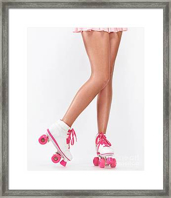 Young Woman Long Legs In Pink Roller Skates Framed Print