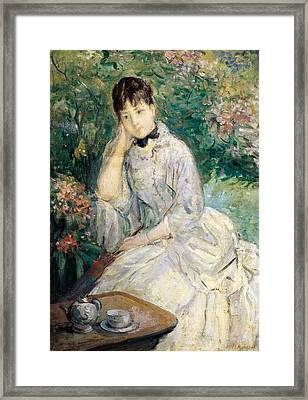 Young Woman Seated On A Sofa Framed Print by Berthe Morisot