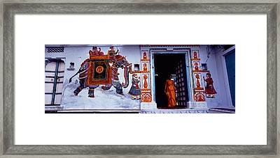 Young Woman Standing At The Door Framed Print by Panoramic Images