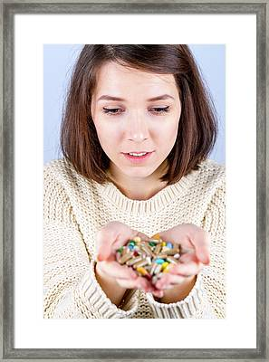 Young Woman With Capsules In Her Hands Framed Print