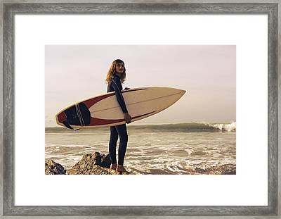 Young Woman With Her Surfboard At The Framed Print by Ben Welsh