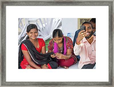 Young Women Check There Mobile Phone Framed Print by Ashley Cooper