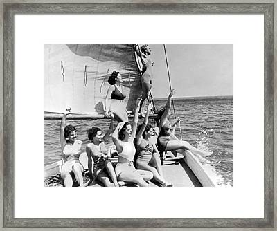 Young Women On A Sailboat. Framed Print by Underwood Archives
