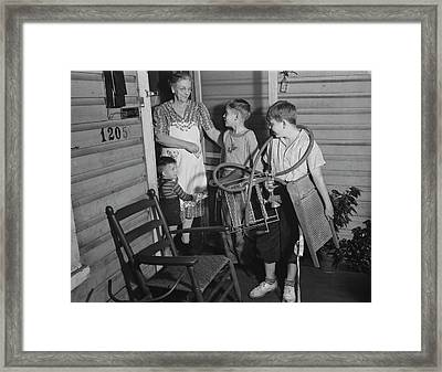 Youngsters Scouring Neighborhoods Framed Print by Stocktrek Images