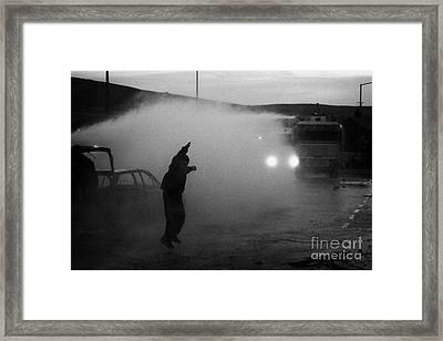 Youth Rioting Being Hit By Water Canon On Crumlin Road At Ardoyne Framed Print by Joe Fox
