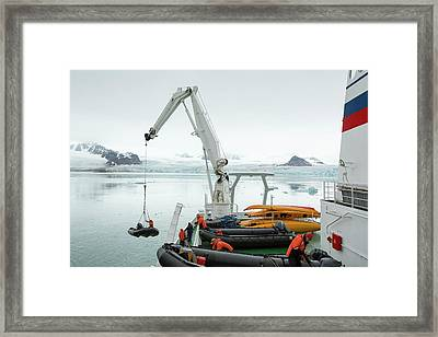 Zodiaks Being Lifted Into The Water Framed Print by Ashley Cooper
