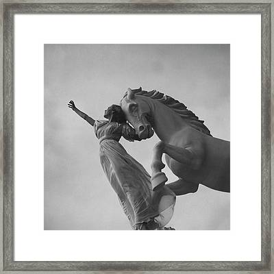 Zorina With A Horse Statue Framed Print by Toni Frissell