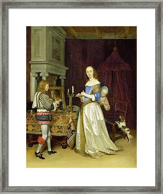 A Lady At Her Toilet Framed Print by Gerard ter Borch
