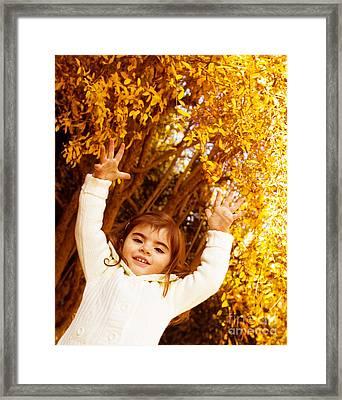 Baby Girl In Autumn Park Framed Print by Anna Om