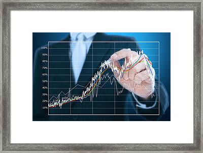 Businessman Writing Graph Of Stock Market  Framed Print by Setsiri Silapasuwanchai
