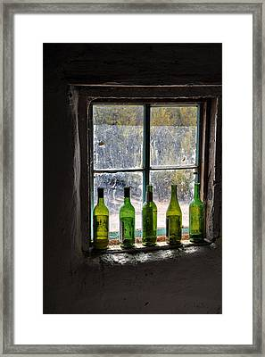 Green Bottles In Window Framed Print