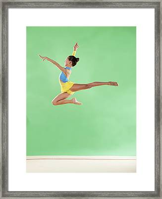 Gymnast,  Mid Air, Jump, Profile Framed Print by Emma Innocenti